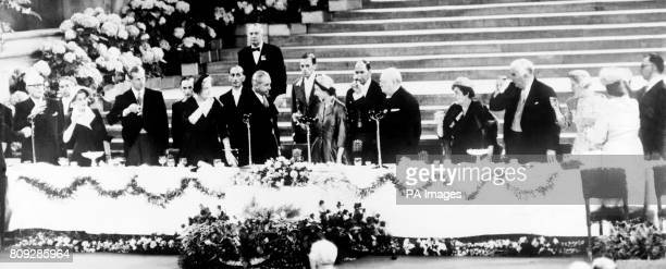Commonwealth Prime Ministers with Queen Elizabeth II at a special Coronation luncheon in Westminster Hall Left to right Louis St Laurent the Canadian...
