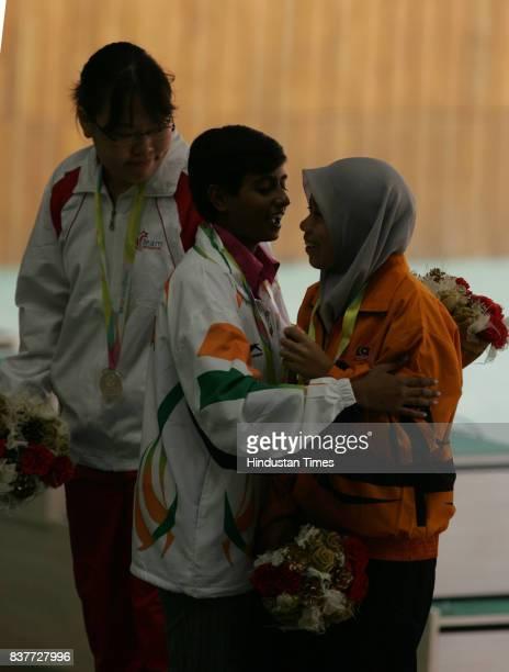 Commonwealth Youth Games 2008 Women Gold medalist winner Deepika Patel encourage her 10m Air Pistol Women Bronze medalist winner Binti Ismail Wahidah...