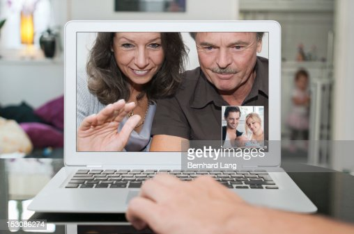 Communicating with grandparents online : Stock Photo