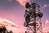 Communication and transmission tower for military use over a magenta sky