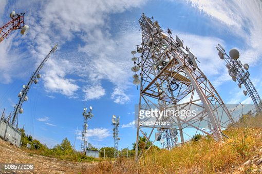 Communication antenna towers in fish-eye perspective : Bildbanksbilder