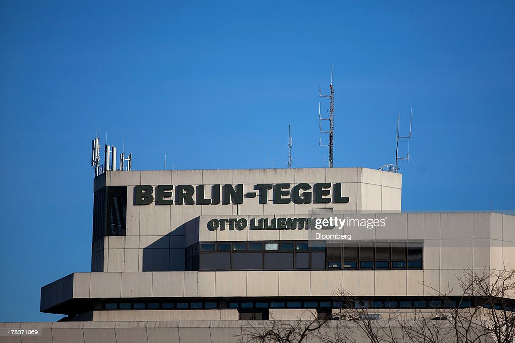 Communication antennae sit on top of Tegel airport, operated by Flughafen Berlin Brandenburg GmbH, in Berlin, Germany, on Wednesday, March 12, 2014. Berlin's Tegel airport has subsisted by chance alone, defying the odds as passenger growth outpaces every other major hub in Western Europe. Photographer: Krisztian Bocsi/Bloomberg via Getty Images