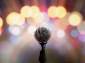 Blurred image, Microphone on stage with blurred bright light background