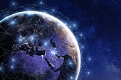Communication network around Earth used for worldwide international connections for finance, banking, internet, and IoT. Image of Earth from NASA (https://eoimages.gsfc.nasa.gov/images/imagerecords/90