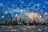 Communication network with multichannel omni channel of Oil and gas refinery at twilight - Petrochemical factory, Technology Smart City with Internet of Things concept