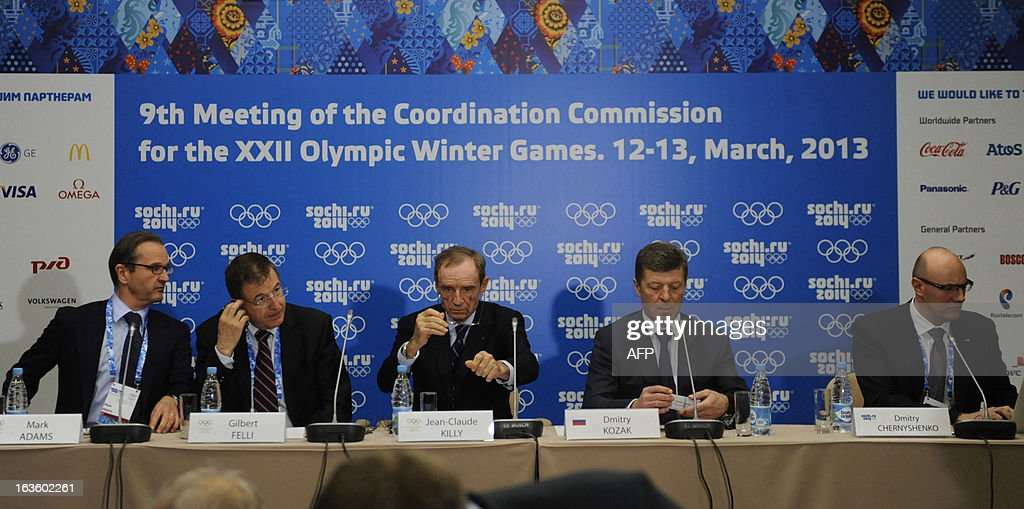 IOC Communications Director,Mark Adams, IOC Executive Director for the Olympic Games Gilbert Felli, IOC Coordination Commission Chairman Jean-Claude Killy, the head of the Sochi 2014 Olympic preparatory commission Russian Deputy Prime Minister Dmitry Kozak and Sochi 2014 CEO Dmitry Chernyshenko attend a press conference on the results of the IOC Coordination Commission's 9th meeting for the XXII Olympic Winter Games in the Russian Black Sea resort of Sochi on March 13, 2013.