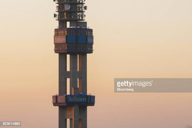 Communications dishes and devices sit on the Telkom Tower operated by Telkom SA SOC Ltd in Pretoria South Africa on Tuesday July 25 2017 South Africa...