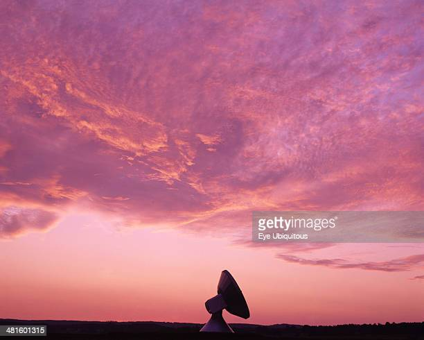 Communications Germany Bavaria Satellite dish against pink and purple sunset sky
