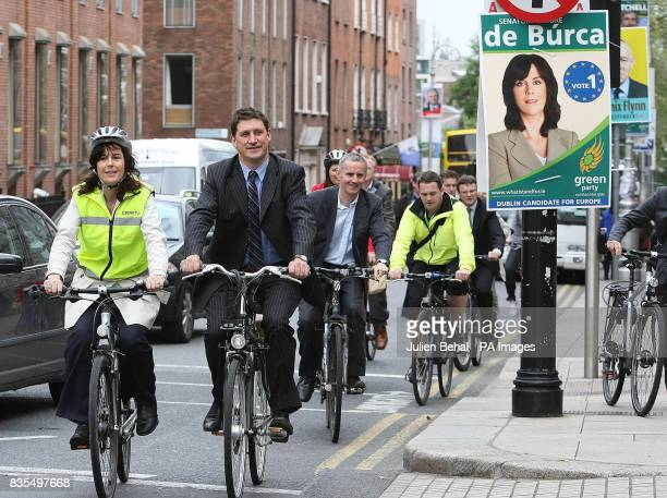 Communications Minister Eamon Ryan cycles through central Dublin with Election European Election candidate Deidre de Burca and journalists during...