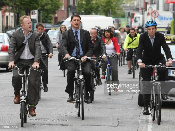 Communications Minister Eamon Ryan cycles through central Dublin with journalists during what he was the world's first mobile news conference to...