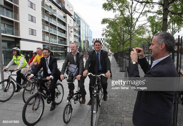 Communications Minister Eamon Ryan has his picture taken by Ciaran Cuffe as he cycles through central Dublin with journalists during what he was the...