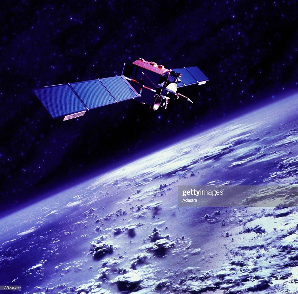 Communications satellite orbiting above Earth