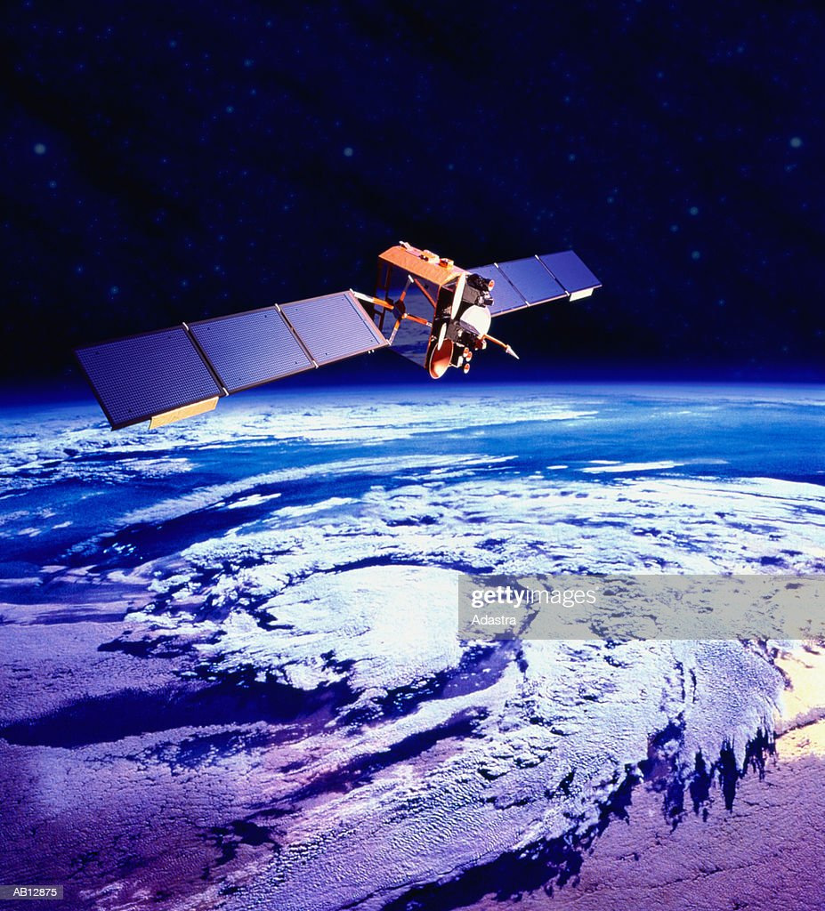 Communications satellite orbiting Earth (digital composite)