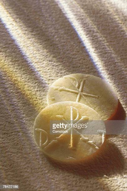 Communion wafers on textured cloth