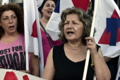 Communist affilited protesters chant slogans during a rally in central Athens to protest layoffs and grinding austerity policies on July 15 2014 AFP...