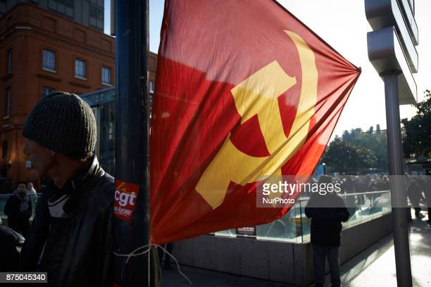 A communist flag on the side of the march More than 4000 protesters took to the streets of Toulouse against the new Macron's reforms on the Work Code...