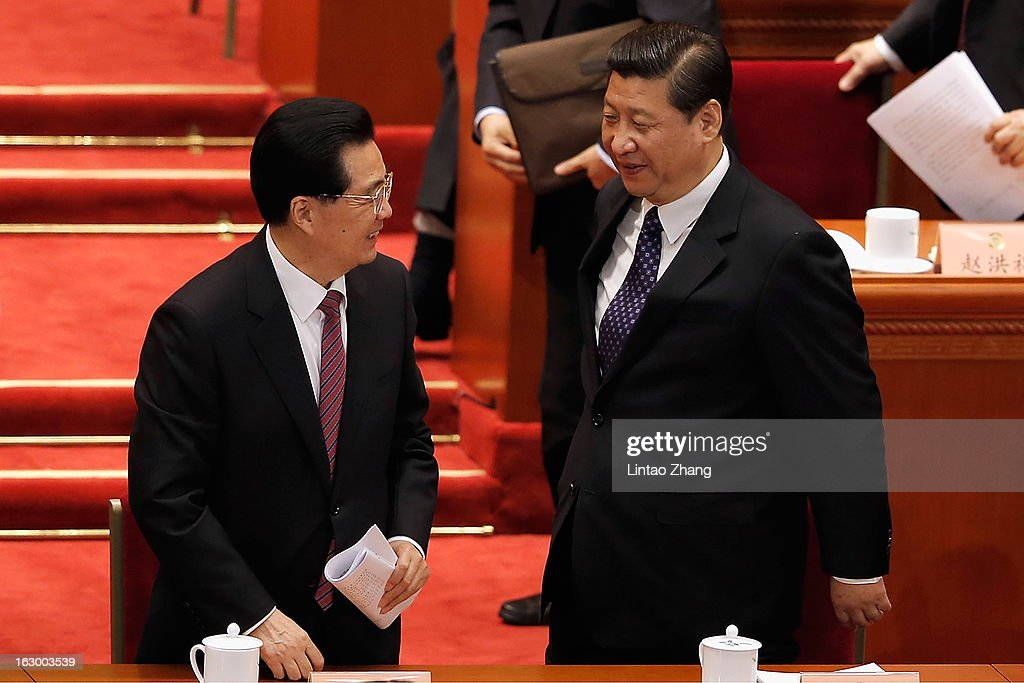 Communist Party chief Xi Jinping (R) and Chinese President Hu Jintao (L) look at each other as they leave after the opening session of Chinese People's Political Consultative Conference at Great Hall of the People on March 3, 2013 in Beijing, China. Over 2000 members of the 12th National Committee of the Chinese People's Political Consultative, a political advisory body, are attending the annual session, during which they will discuss the development of China.