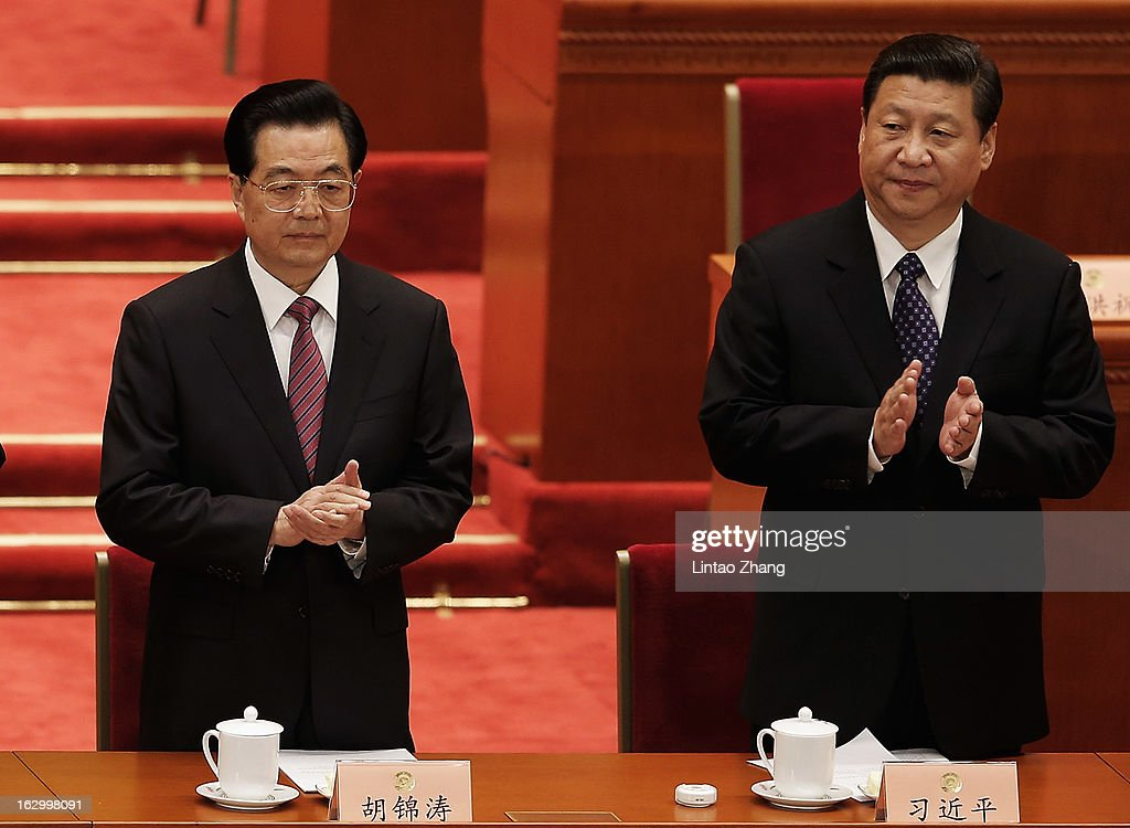 Communist Party chief <a gi-track='captionPersonalityLinkClicked' href=/galleries/search?phrase=Xi+Jinping&family=editorial&specificpeople=2598986 ng-click='$event.stopPropagation()'>Xi Jinping</a> (R) and Chinese President <a gi-track='captionPersonalityLinkClicked' href=/galleries/search?phrase=Hu+Jintao&family=editorial&specificpeople=203109 ng-click='$event.stopPropagation()'>Hu Jintao</a> (L) applaud during the opening session of The Chinese People's Political Consultative Conference at the Great Hall of the People on March 3, 2013 in Beijing, China. Over 2000 members of the 12th National Committee of the Chinese People's Political Consultative, a political advisory body, are attending the annual session, during which they will discuss the development of China.
