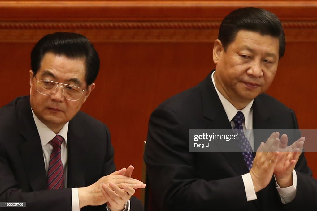 Communist Party chief Xi Jinping (R) and Chinese President Hu Jintao (L) applaud during the opening session of the Chinese People's Political Consultative Conference in Beijing's Great Hall of the People on March 3, 2013 in Beijing, China. Over 2,000 members of the 12th National Committee of the Chinese People's Political Consultative, a political advisory body, are attending the annual session, during which they will discuss the development of China.