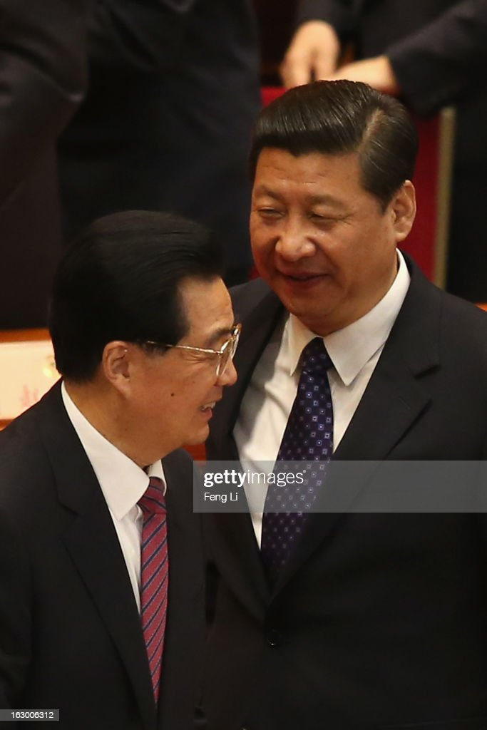 Communist Party chief Xi Jinping (R) and Chinese President Hu Jintao (L) leave after attending the opening session of the Chinese People's Political Consultative Conference in Beijing's Great Hall of the People on March 3, 2013 in Beijing, China.