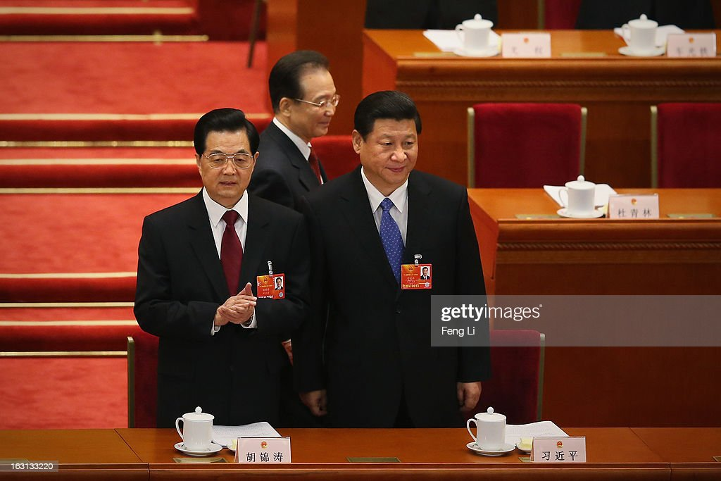 Communist Party chief Xi Jinping (R), Chinese President Hu Jintao (L) and Chinese Premier Wen Jiabao (C) arrive for the opening session of the annual National People's Congress in Beijing's Great Hall of the People on March 5, 2013 in Beijing, China. Chinese Premier Wen Jiabao stressed Tuesday that the government should adopt effective measures to prevent and control pollution in response to people's expectations of having a good living environment.