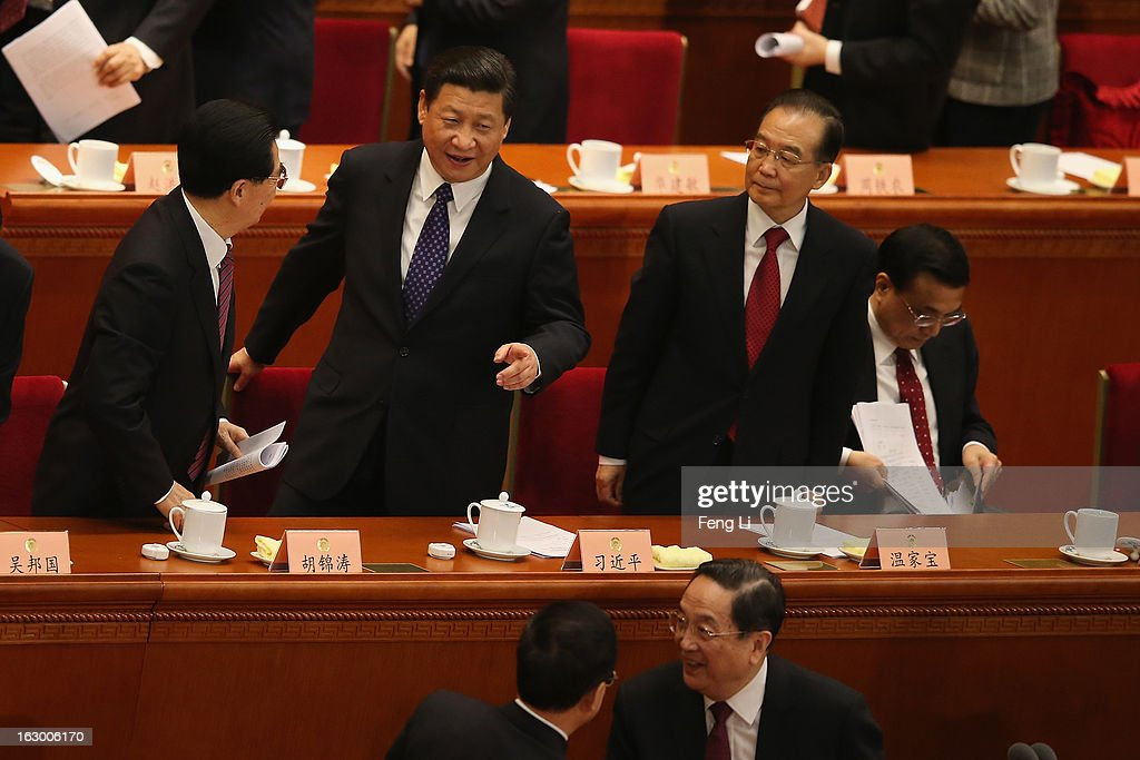 Communist Party chief Xi Jinping (2nd L), Chinese President Hu Jintao (L), Chinese Premier Wen Jiabao (2nd R) and Chinese Vice Premier Li Keqiang (R) leave after attending the opening session of the Chinese People's Political Consultative Conference in Beijing's Great Hall of the People on March 3, 2013 in Beijing, China.