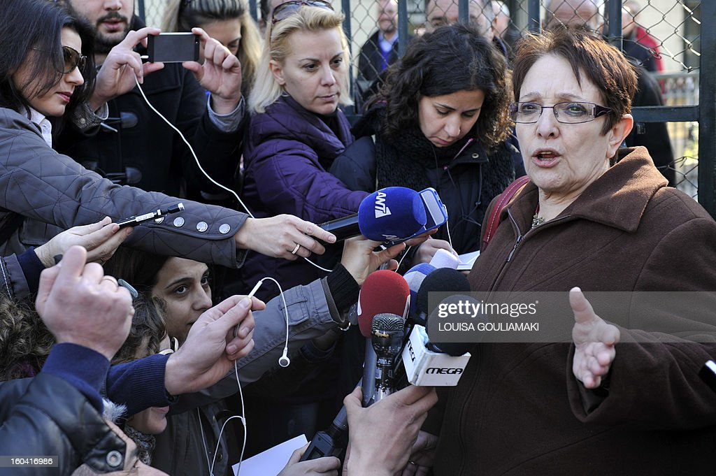 Communist party leader, Aleka Papariga talks to media in front of the Athens court , during a gathering of communist affiliated protesters to support their arrested colleagues on January 31, 2013. Around 30 Communist unionists were arrested after attempting to occupy the office of Labour Minister Yiannis Vroutsis on January 30th. Vroutsis had previously announced a new pension overhaul. A street protest was organised outside the Athens court complex on Thursday morning to demand the release of those arrested. AFP PHOTO / LOUISA GOULIAMAKI