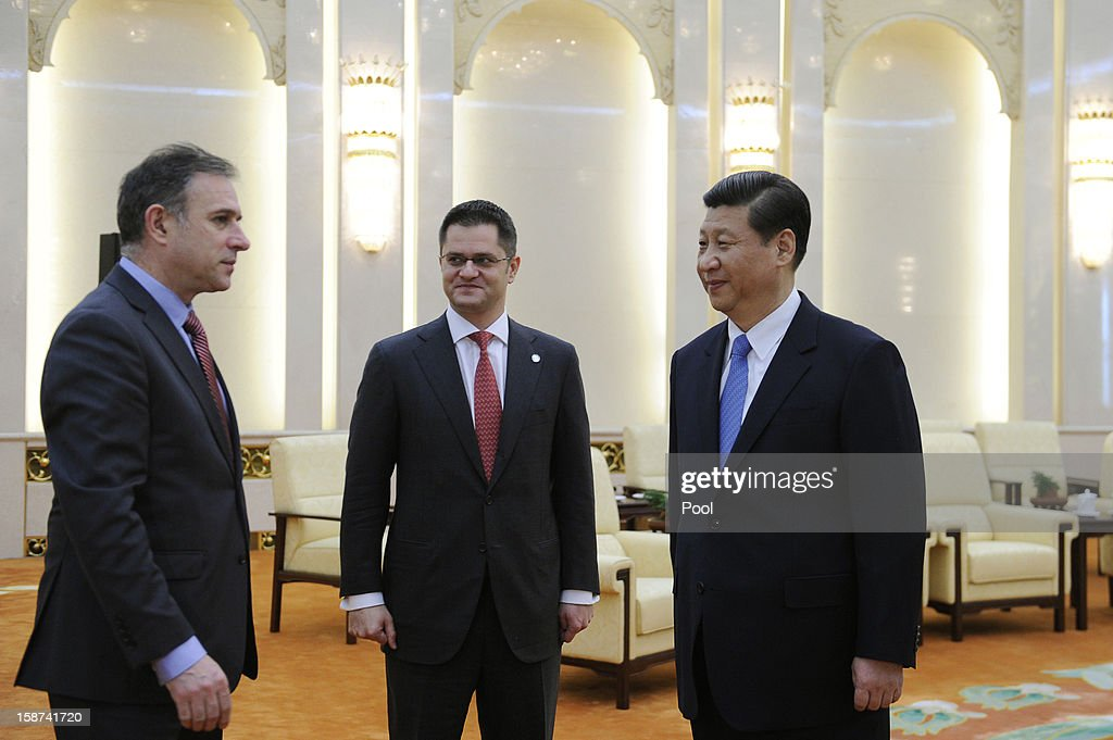Communist Party leader Xi Jinping (R) prepares to shake hands with Vuk Jeremic (C), president of the 67th Session of the UN General Assembly, at the Great Hall of the People on December 27, 2012 in Beijing, China. UN General Assembly President Vuk Jeremic is visiting China through December 28.
