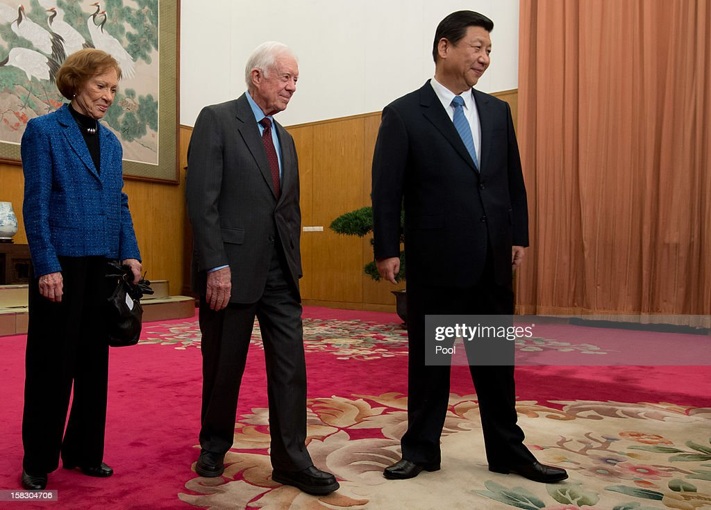 Communist Party leader <a gi-track='captionPersonalityLinkClicked' href=/galleries/search?phrase=Xi+Jinping&family=editorial&specificpeople=2598986 ng-click='$event.stopPropagation()'>Xi Jinping</a> (R) stands with former US President <a gi-track='captionPersonalityLinkClicked' href=/galleries/search?phrase=Jimmy+Carter+-+US+President&family=editorial&specificpeople=93589 ng-click='$event.stopPropagation()'>Jimmy Carter</a> (C) as his wife Rosilyn looks on in room 202 of the Zhongnanhai leadership compound on December 13, 2012 in Beijing, China. Carter congratulated Xi on his new position before the pair sat down for talks.