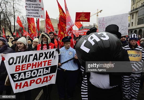 Communist Party members hold a protest against the EU's sanctions in Russia and the decline of the Russian ruble against the euro and dollars on...