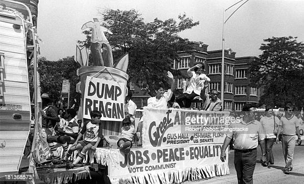 Communist Party nominee for VicePresident Angela Davis waves to the crowd while riding in a float during the annual Bud Billiken parade sponsored by...