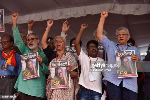 Communist Party of India leader Sitaram Yechury and social activist Medha Patkar join the public rally by the Forum against the assassination of...
