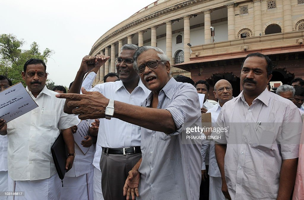 Communist Party of India leaders D Raja and Gurudas Dasgupta shout slogans against the United Progressive Alliance coalition government's inability...