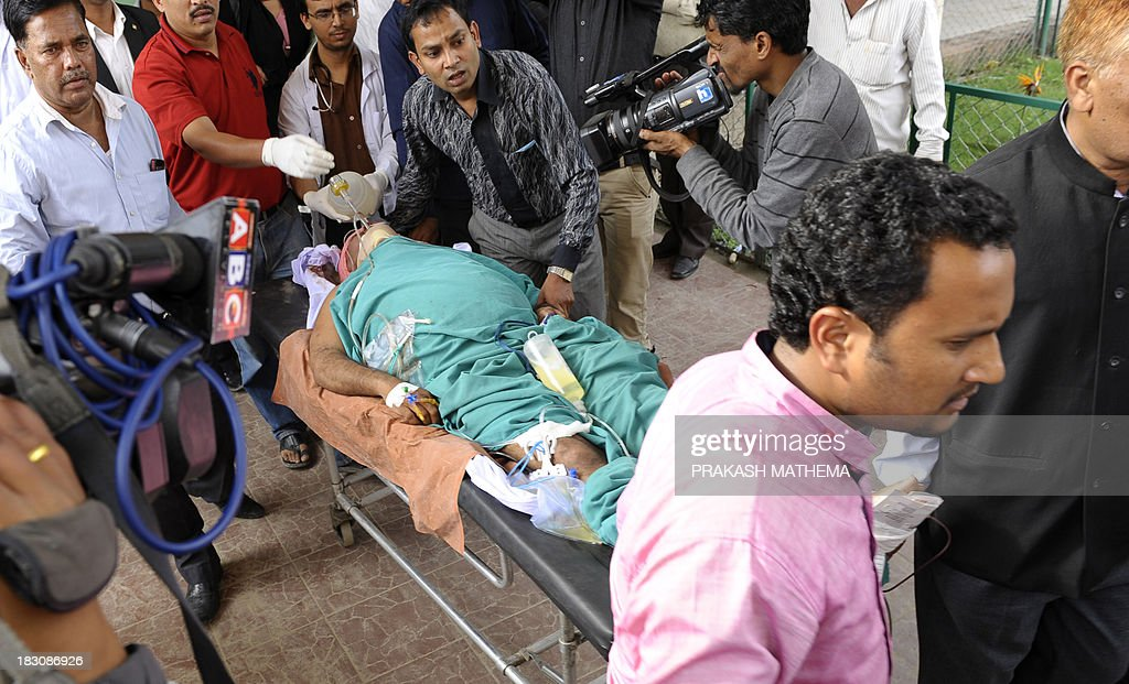 Communist Party of Nepal (Unified Marxist-Leninist) (CPN-UML) candidate Mohammad Alam arrives on a medical gurney at the Teaching hospital in Kathmandu on October 4, 2013. Gunmen shot an election candidate in southern Nepal, police said, fuelling fears about security before crucial national polls November 2014. AFP PHOTO/Prakash MATHEMA