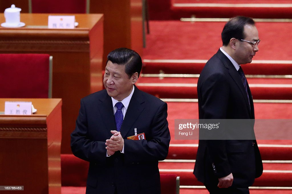 Communist Party Secretary of Chongqing Sun Zhengcai (R) walks behind Chinese President Xi Jinping (L) as they attending the fifth plenary meeting of the National People's Congress at the Great Hall of the People on March 15, 2013 in Beijing, China. Li Keqiang was elected as China's Premier Friday at the 12th National People's Congress, the country's top legislature.