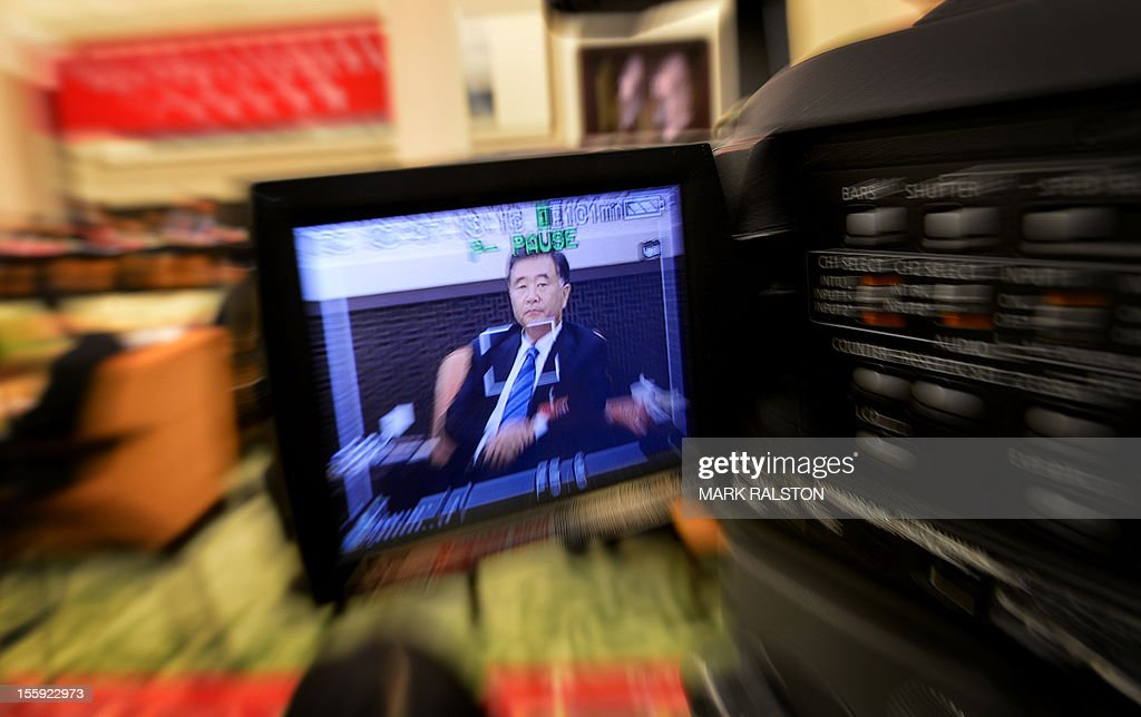 Communist Party Secretary of Guangdong Province, Wang Yang is seen on a LCD panel of a video camera during a press conference at the Great Hall of the People in Beijing on November 9, 2012. The heirs of Mao Zedong are meeting to anoint China's next leaders, as the Communist Party maintains an iron grip on the economic powerhouse despite mounting calls for change in the Internet era. AFP PHOTO/Mark RALSTON