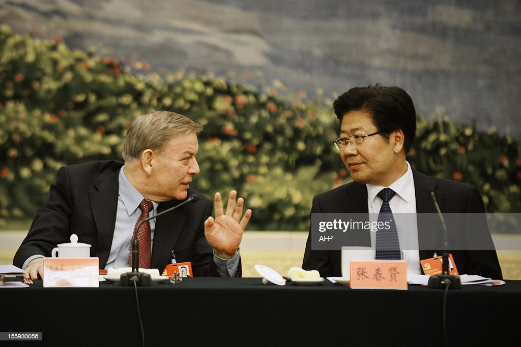 Communist Party Secretary of Xinjiang Uygur Autonomous Region, Zhang Chunxian(R) talks with a delegate during a panel discussion of Xinjiang delegation to the 18th National Congress of the Communist Party of China at the Great Hall of the People in Beijing on November 9,2012. Vice President Xi Jinping had moved closer to taking the reins of power and is expected to replace President Hu Jintao as party chief in a once-a-decade power transition, setting the stage for his promotion to president of the world's most populous nation, expected by March 2013.