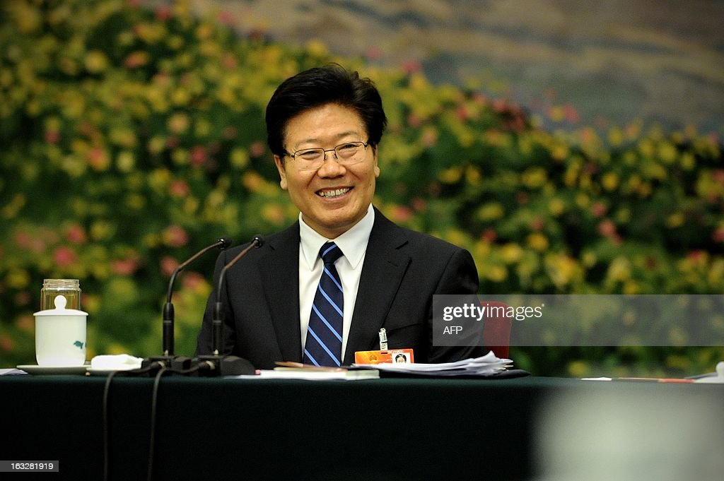 Communist Party Secretary of Xinjiang Uygur Autonomous Region, Zhang Chunxian laughs during the Xinjiang Uygur Autonomous Region open session as part of the National People's Congress (NPC) events in Beijing on March 7, 2013. Thousands of delegates from across China meet this week to seal a power transfer to new leaders whose first months running the Communist Party have pumped up expectations with a deluge of propaganda. in Beijing on March 6, 2013. China announced a further double-digit rise in its defence budget on March 5, underlining its military ambitions with Beijing embroiled in a series of territorial disputes with its neighbours. AFP PHOTO / WANG ZHAO