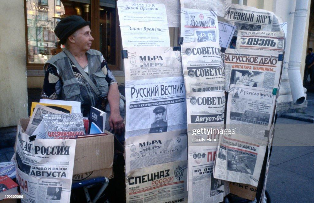 Communist selling left-wing news outside Gostiny Dvor. : Stock Photo
