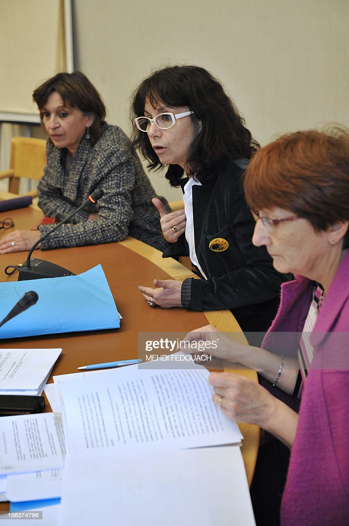 Communist senator Laurence Cohen (C) delivers a speech next to President of the CRC communist group at the Senate Eliane Assassides (L) and Senator Marie-France Beaufils (R), on November 14, 2012 at the Senate in Paris, during a press conference focused on the 2013 social care budget.