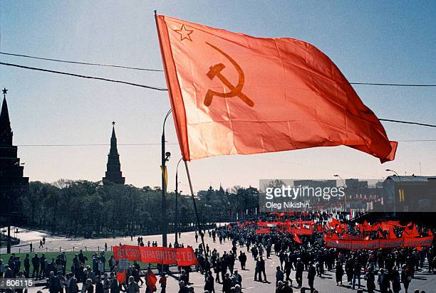 Communist supporters with red flags and banners march along a bridge near the Kremlin May 1 2001 in downtown Moscow Russia during May Day...