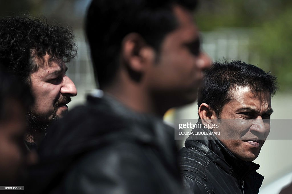 Communist-affiliated PAME union and Bangladeshi migrant workers protest outside the Civil Protection Ministry in Athens on April 18, 2013 calling for the immediate punishment of the gunmen who shot at migrant strawberry pickers. Police said on April 18 they had arrested two men in connection with the attack by strawberry growers on unpaid migrant labourers that left 27 injured, one of them in critical condition. PAME said the workers had been fired upon with shotguns and pistols. It claimed 33 were hurt, while the police said 27 were wounded, one of them critically. 'Growers and landowners have operated with cover from the government and justice for years, creating a hell-hole with slavery labor conditions,' the union said. AFP PHOTO/LOUISA GOULIAMAKI