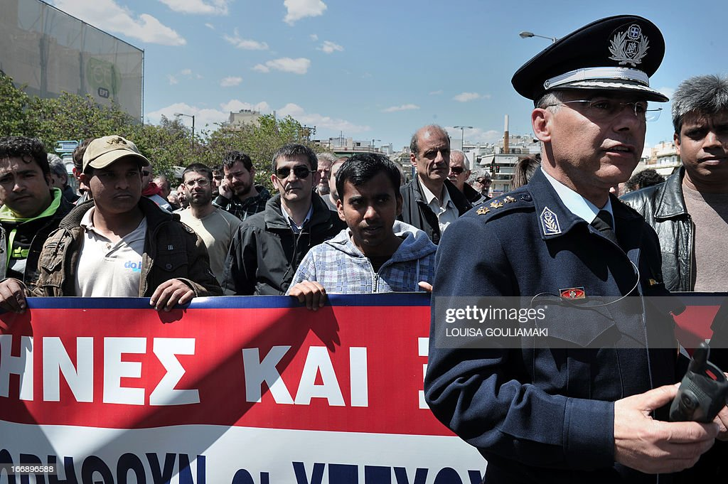 Communist-affiliated PAME union and Bangladeshi migrant workers protest outside the Civil Protection Ministry in Athens on April 18, 2013 calling for the immediate punishment of the gunmen who shot at migrant strawberry pickers. Police said on April 18 they had arrested two men in connection with the attack by strawberry growers on unpaid migrant labourers that left 27 injured, one of them in critical condition. PAME said the workers had been fired upon with shotguns and pistols. It claimed 33 were hurt, while the police said 27 were wounded, one of them critically. 'Growers and landowners have operated with cover from the government and justice for years, creating a hell-hole with slavery labor conditions,' the union said.
