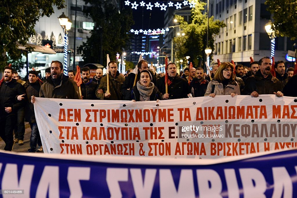 Communistaffiliated protesters march towards the Greek parliament in Athens on December 15 2015 as MPs vote on a set of reforms demanded by creditors...