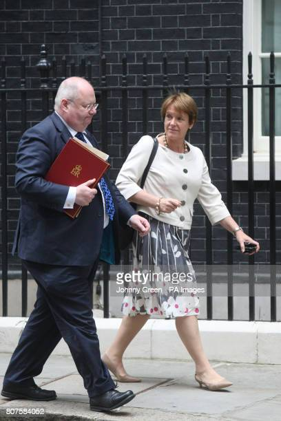 Communities and Local Government Secretary Eric Pickles and Environment Food and Rural Affairs Secretary Caroline Spelman leave 10 Downing Street in...