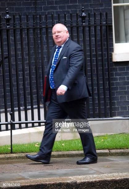 Communities and Local Government Secretary Eric Pickles arrives in Downing Street for a cabinet meeting