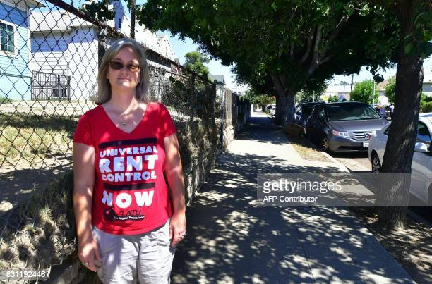 Community activist Elizabeth Blaney is interviewed in front of the apartment block where with no rent control due to the year it was built the...