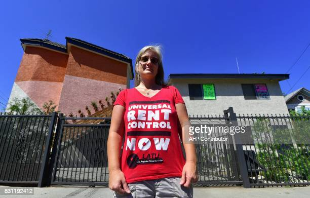 Community activist Elizabeth Blaney stands in front of the apartment block where with no rent control due to the year it was built the landlord has...