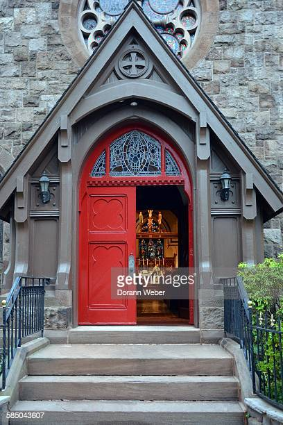 Community church seen with open red door as mass is in process