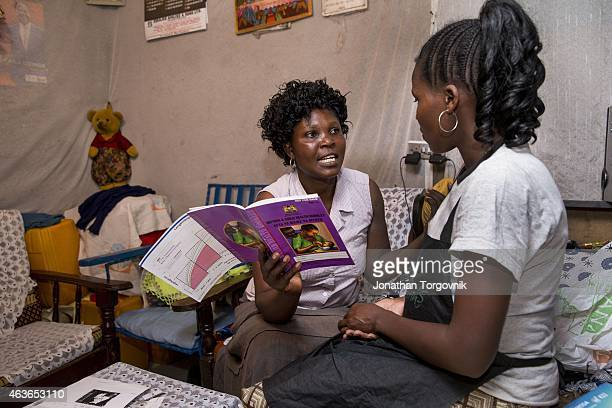 Community health worker supported by APHRC visiting a young mother at her home in Korogocho slum one of Nairobi's most populated informal settlements...